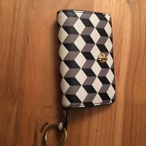 Key holder with interior pouch